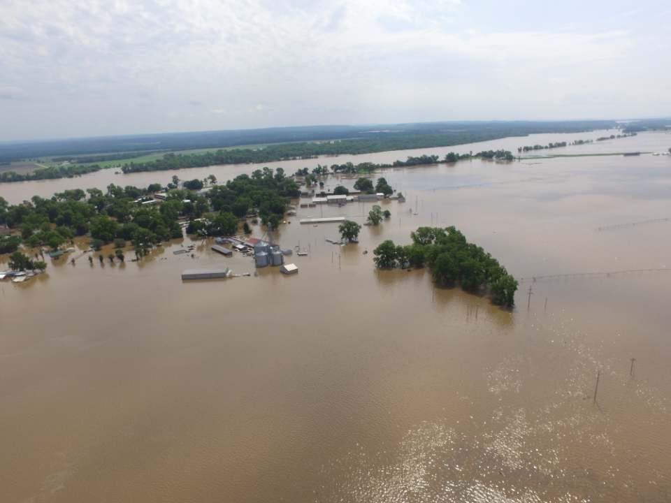 Catastrophic Flooding in Webbers Falls, Oklahoma in May 2019 showing homes and farms under water.